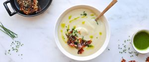 creamy white miso + cauliflower soup with candied furikake prosciutto + garlic chive oil