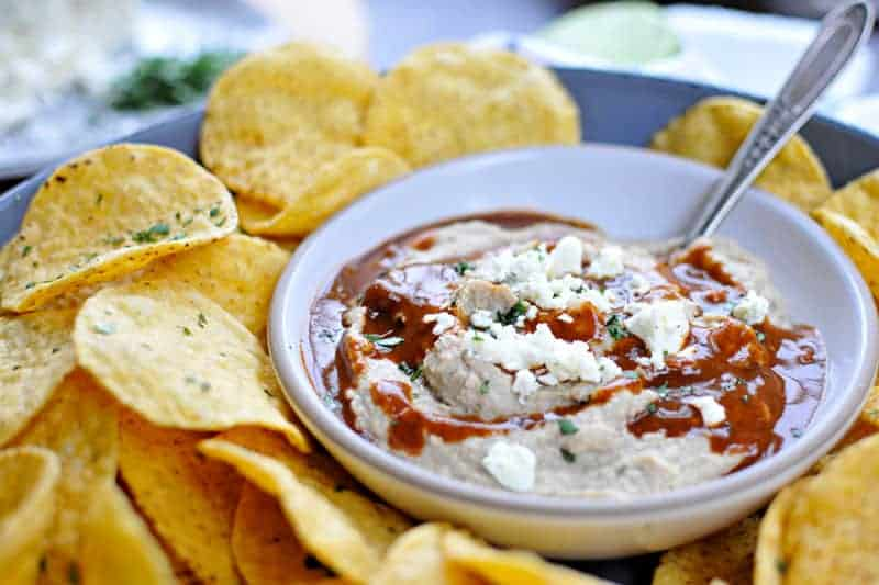 Two recipes in one: toasty, nutty hummus drizzled with a fast and foolproof spicy sauce. Super addicting! Full recipe at www.thepigandquill.com. #vegan #superbowl #snacks #recipe