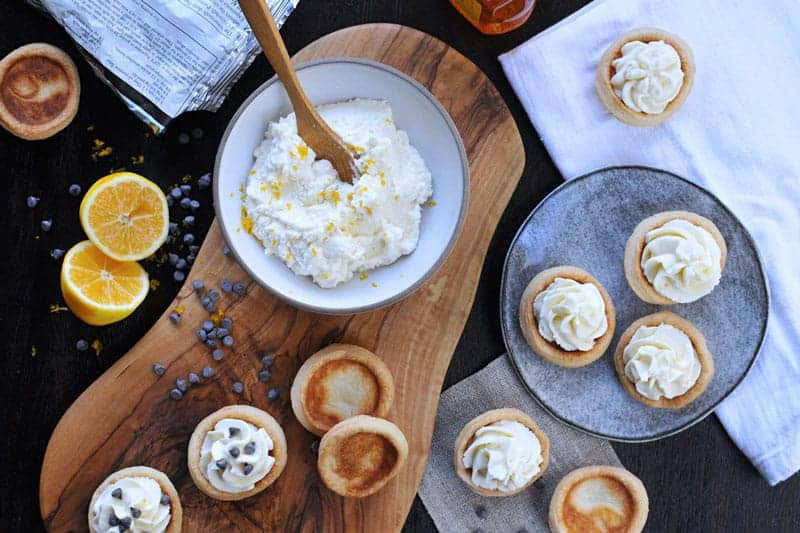 mini meyer lemon cannoli cream tartlets with honey + chocolate chips | via thepigandquill.com