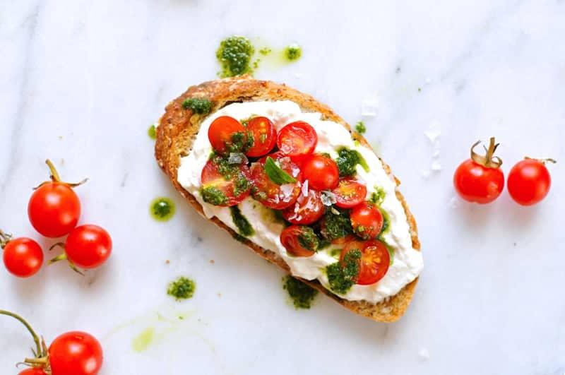 Whipped Ricotta Toast Two Ways recipe: Tomatoes, Basil Oil, Sea Salt // Summer Fruit, Honey, Black Pepper (via thepigandquill.com) #breakfast #brunch #summer #vegetarian