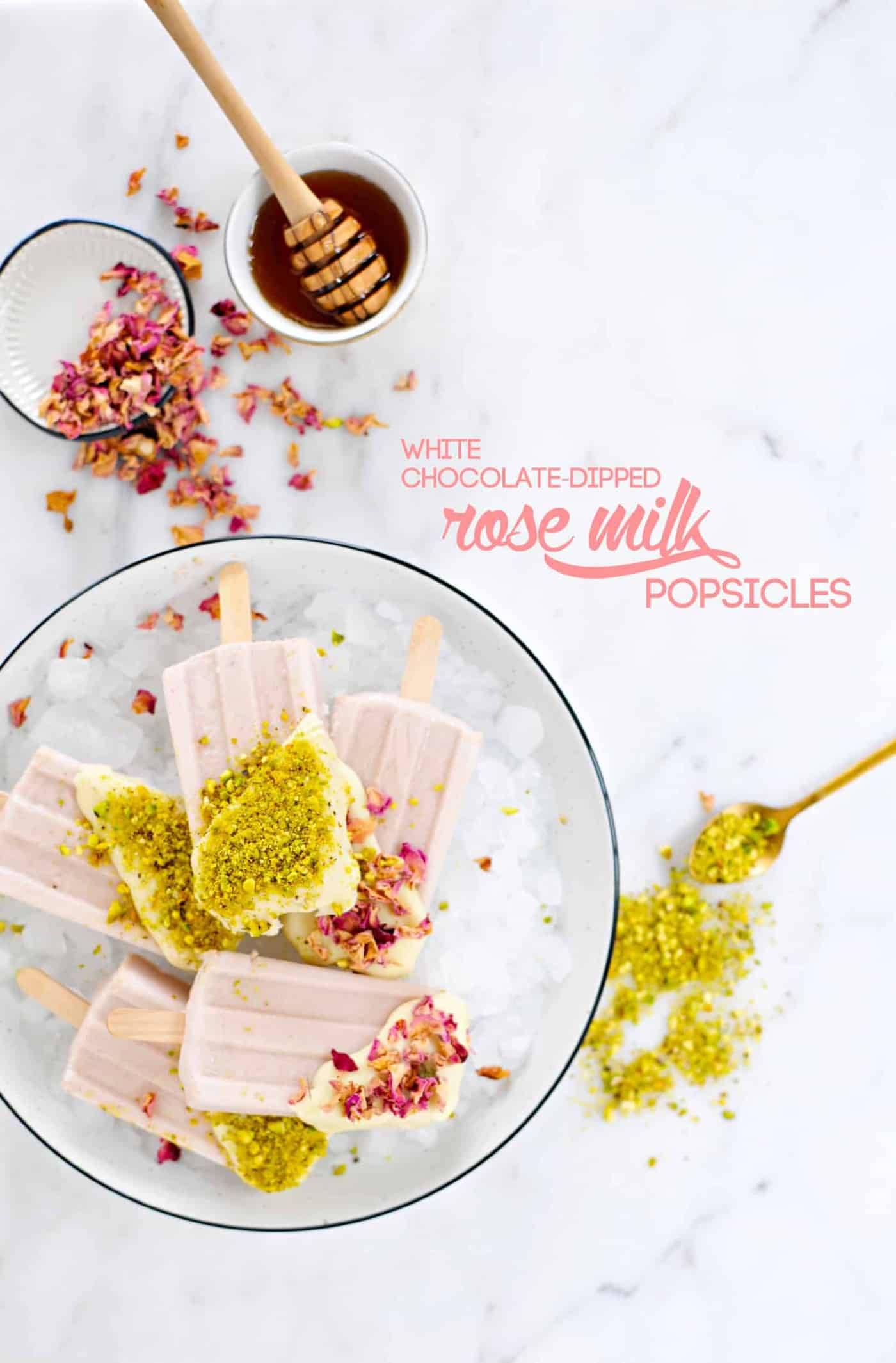 White Chocolate Dipped Rose Milk Popsicles recipe (via thepigandquill.com) #summer #dessert #pistachios