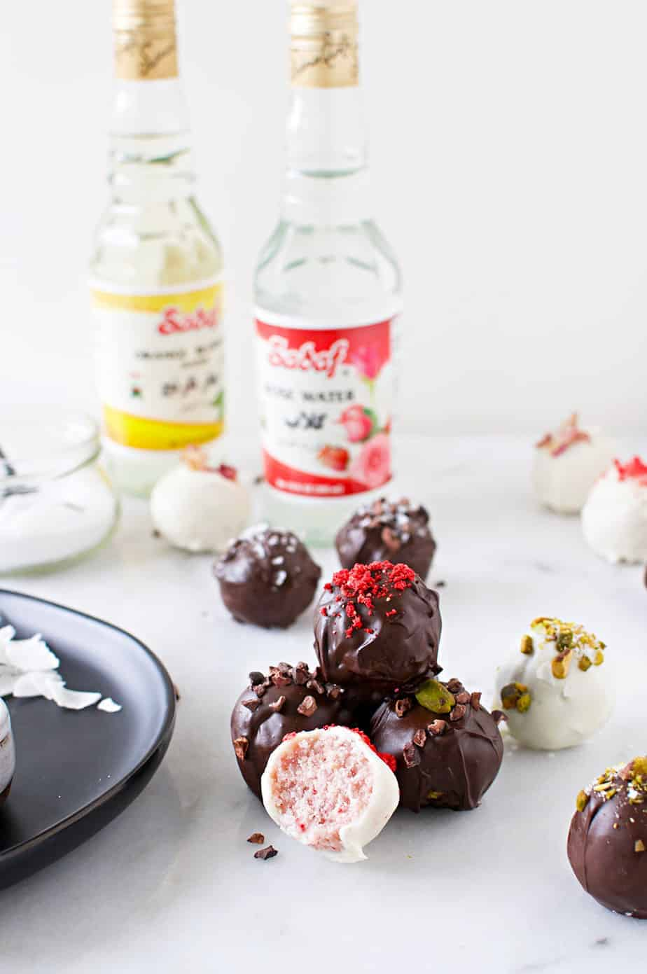 Vegan Coconut Truffles two ways: Vegan Rose Truffles and Vegan Pistachio Truffles recipe (via thepigandqill.com) #glutenfree #candy #sweets #valentinesday #chocolate #coconutbutter