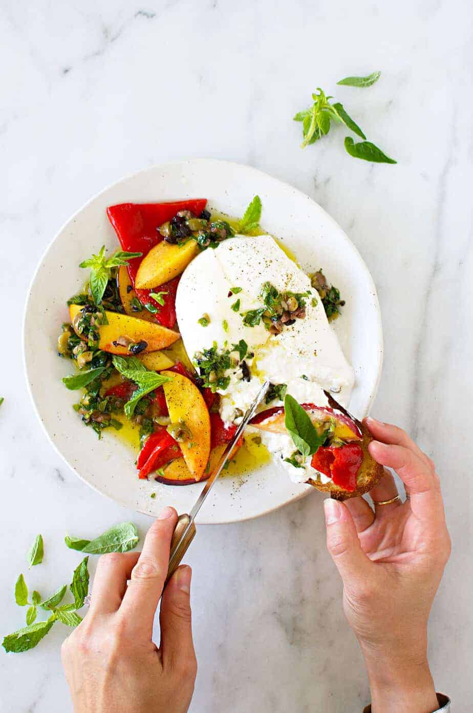 Burrata Appetizer with Mediterranean Honey Herb Oil, Nectarines + Roasted Peppers recipe (via thepigandquill.com)